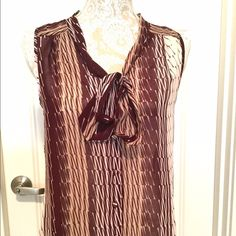 Banana Republic Sheer Blouse, Size XS Beautiful print in a deep burgundy brownish color with cream.  Fabric is 100% polyester and is sheer.  Button up front, tie front (or leave untied), sleeveless vneck.  Great on its own or paired with a cardigan or blazer.  Banana Republic Factory, Size XS.  No snags, tears or stains, great condition! Banana Republic Tops Blouses