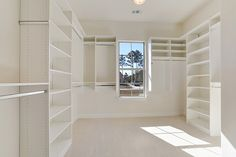 Well lit HUGE walk-in closet for master with built-in shelving and organized space