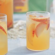 3 plums, halved, pitted and cut into thin wedges  3 nectarines, halved, pitted and cut into thin wedges  1 can (12 fl. oz.) nectarine nectar  1/4 cup orange liqueur  1 bottle (750ml) dry white wine  Ice cubes as needed  1 bottle (24 fl. oz.) sparkling water, chilled