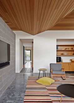 Melbourne house by MRTN Architects features a faceted wooden ceiling
