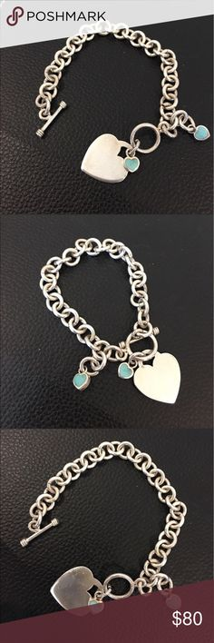 Sterling w turquoise heart charm bracelet, 31.4g Lovely and feminine Sterling silver bracelet with a large heart  charm accompanied by two inlaid sleeping beauty / Tiffany blue turquoise dangling heart charms. Marked 925 on clasp (see photo), weighs a substantial 31.4 grams. See photo for measurements. Features large links w toggle clasp closure. In nice gently worn preowned condition w gentle scratches on charm. Pls ask questions prior to purchase. Trades. Reasonable offers only considered…