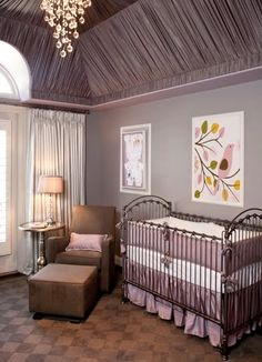 Beautiful baby nursery with draped ceilings and chandelier