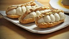 Salted caramel and coffee éclairs... These grown-up éclairs are very straightforward and will have you wowing family and friends. Equipment and preparation: you will need a piping bag fitted with a 1cm/½in plain nozzle... Less than 30 mins preparation time... 30 mins to 1 hour cooking time... Makes 8...