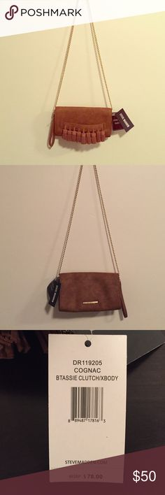 Steve Madden Crossbody Clutch This is a Steve Madden Cross Body Clutch with Genuine brown Suede. This clutch has9 decorative tassels on the front. It also has gold hardware and the chain is about 45 inches long. The Purse itself is about 10 inches long and 2 inches wide. Steve Madden Bags Crossbody Bags