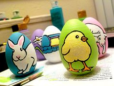 Hand-painted Easter Eggs by Emily Hawkins, acrylic on wood.