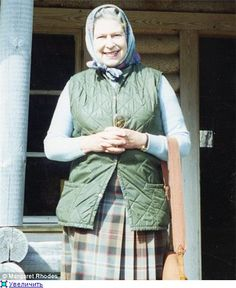 Her Majesty, smiling, probably in the countryside near Balmoral Castle.  Can I get more info on this?  i love it.