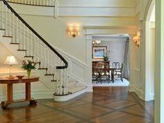 Wood detailing around doorway to dining/living room
