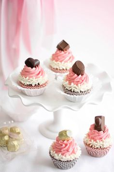 """Neapolitan Bonbon Cupcakes. """"These cupcakes are all about variety. You get a little of everything - rich chocolate cake, vanilla and strawberry buttercream, and a surprise flavor-filled bonbon on top!"""" Gorgeous."""