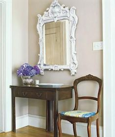 """A mirror also works to create the illusion of extra space by visually """"expanding"""" a contained area. Just make sure that it is in proportion to the dimensions of the foyer"""