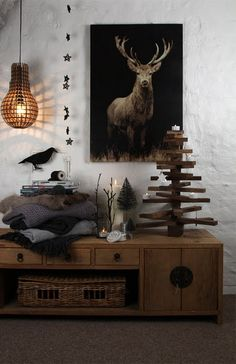 antler art in a black, white and wood livingroom. Very distinguished interior decorating.