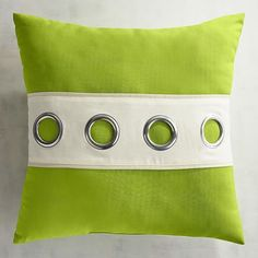 Finely woven and soft to the touch, our Cabana fabric is tough enough for outdoors but pretty enough for indoors. This grommet-trimmed pillow will add a trendy touch to your patio or family room.