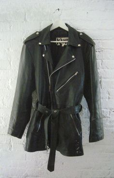 90s Black Leather Jacket Vintage Motorcycle Jacket Grunge Car Coat Punk Goth Metal Steampunk Burberry style Unisex Plus Size Biker Jacket. $130.00, via Etsy.