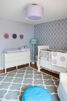 The wall color is Ben Moore Misty Memories 2118-60 and the stencil color is Ben Moore Excalibur Gray 2118-50. The nursery was designed by Cathy Green Interiors. All selections were made by her. All painting and stencil applications were done by Barden's Decorating, Inc.
