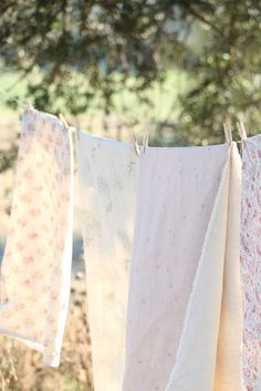 The music of clothes, sheets, and quilts lightly snapping and popping in the fragrant breeze ....