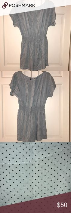 BCBG Romper, M **First picture is a similar BCBG style, to show what it would look like on.  This romper for sale (picture 2-5) has a silk-like material with a small pattern on it.  It's super light weight and flowy, besides the elastic waist!  SO CUTE! Gently-used. Baby blue with black (maybe navy) triangles. Cross back with button closure. Track-like detailing on the shorts. Has pockets! Comes from a smoke-free home!  (I leave it up to the buyer to iron it when they receive their item…