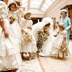 Princess Diana always attracted to children.  Here she's talking to one of her flower girls.
