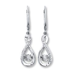 A diamond shimmers as it moves inside of each of these infinity earrings for her…