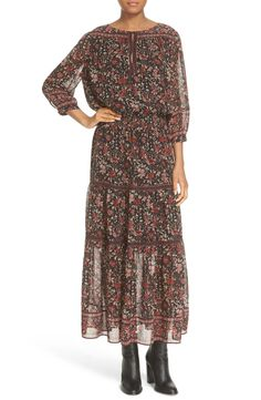 Swooning over this autumn floral printed peasant dress with a deeply split neckline and billowed sleeves for a boho-chic look.