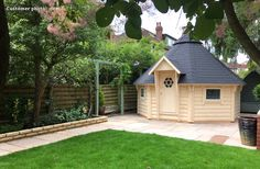 A large Nordic barbecue hut made with walls, ready made roof, double glazed windows and a choice of treatment colours, shingles and grill stove Bbq Grill, Barbecue, Small Bbq, Bbq Hut, Timber Walls, She Sheds, Double Glazed Window, Play Houses, Pavilion