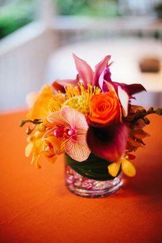 Kauai Destination Wedding - vibrant colored centerpieces, love.