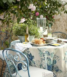 love the tablecloth & color of the chairs #blue #roses #dining