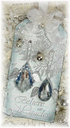 Love how rich this looks - soft blue, silver and shiny jewels; elegant feel