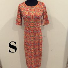 Julia dress The Julia Dress is a form fitting, knee-length, knit dress with mid-length sleeves and a high neckline. Its simple silhouette makes the Julia Dress a great canvas for layering and accessorizing. It's feminine, flattering, and you may not ever want to take it off. LuLaRoe Dresses Midi