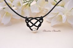 This is such a sweet, simple and spectacular touch to any jewelry wardrobe. This Pearl and Leather Celtic Heart Knot Necklace is made of 2mm