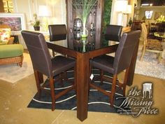 """Contemporary style pub table with a black glass top set on dark wood frame with four chairs. 54""""square x 36""""high. Great for a casual kitchen or dining area. The chairs are done in a dark brown. Lovely! Arrived: Tuesday November 22nd, 2016"""