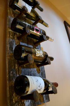 DIY Barn Wood and Railroad Spike Wall Wine Rack