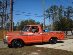 """1975 Ford F-100 lowered over 20"""" Dodge Ram spares."""