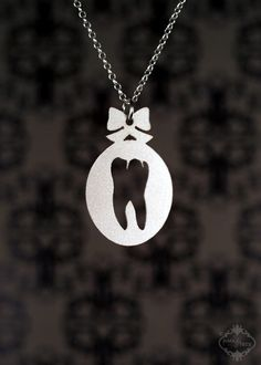 Sweet Tooth necklace in silver stainless steel - Molar anatomical science geekery jewelry. $19.00, via Etsy.
