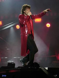 Mick J in concert. Unknown year/location.  He did wear this red jacket with tails (or one just like it) during May 24, 2015 San diego Petco Park concert.