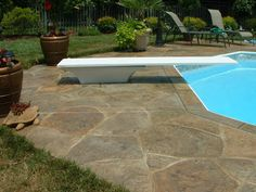 Pool deck resurfaced with a stamped concrete overlay. Sundek of Washington Chantilly, VA