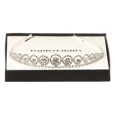 You'll look like a true princess in this stunning tiara. The piece will lend outfits some sparkling glamour, ensuring you turn up in dramatic style while your fans cheer on. Designed with glittering rhinestones and gemstones.