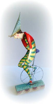 Unicycle boy - beautiful piece of papier mache art.