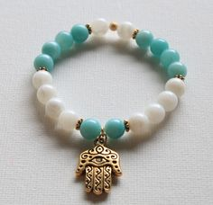 Aqua Blue Amazonite and Mother of Pearl Semi Precious gemstone Hamsa hand strech beaded bracelet. via Etsy.