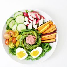 spinach and arugula, baby heirloom tomatoes, cucumber, radishes, rainbow carrots, avocado, homemade beet hummus, @vitalfarms soft boiled eggs, and @salbachia chia seeds