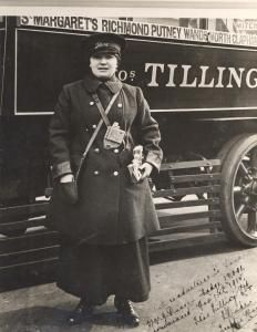 London's first woman bus conductor Mrs G Duncan, employed by Thomas Tilling in 1915, poses in front of one of the company's buses