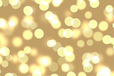 Bokeh, or blurred background lights in gold and white. Description from rgbstock.com. I searched for this on bing.com/images