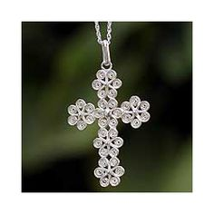 @Overstock - Necklace features filigree flowers blossoming into a cross of sublime elegance  World jewelry is crafted of sterling silver  Cross pendant is handcrafted by a Peruvian designerhttp://www.overstock.com/Worldstock-Fair-Trade/Sterling-Silver-Filigree-Flowers-Cross-Necklace-Peru/4387998/product.html?CID=214117 $79.99