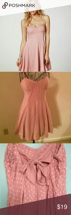American Eagle pink polka dot sun dress This dress is a peachy soft pink color with white polka dots. Spaghetti straps and a tie key hole back. There is an invisible side zipper to get it on and off. Hits mid thigh and is flowy. Padded cups in the chest for support so no need for a bra. I have this dress in royal blue so I always choose that one over this one. I think I have worn this maybe 3 times total. Soft cotton fabric. I do not recommend putting this in the dryer ever, just hang dry as…