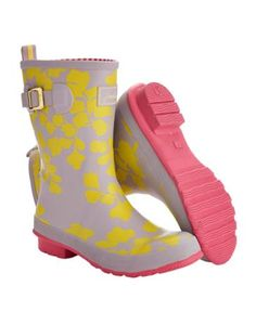 Joules Women's Mid-Height Rain Boot Wellies, Yellow Wildflower.                     Our mid-height rain boot welly, that is perfect for all calf sizes, is splashed with heritage-inspired prints. For a jaunt outdoors when puddles are present, these are a great way to keep your feet covered.