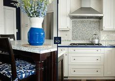 It's in the details! From the backsplash to the gorgeous blue vase, this Coastal Kitchen idea by KBW & Associates is so well done.