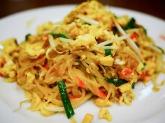 Do You Know That Pad Thai Isn't Originally from Thailand? Stir-fried rice noodles or Char Kuay Teow was introduced to Siam by Chinese traders 400 years ago. But it wasn't until WWII that Pad Thai gained its name. Due to a rice shortage during the war, a Thai PM encouraged Thais to eat noodles instead of rice. The noodle recipe was altered and flavoured by match Thai tongues - Pad Thai was born.  Tipsamai Restaurant is known for the best Pad Thai in Bkk. Come try it with us!