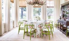 Maureen this is the look I envision for your dining room. Woven blinds at a minimum and if you still wish for added panache...than drapery panels can be hung...note the big pop of color on the tablecloth and chairs and the fun chandelier