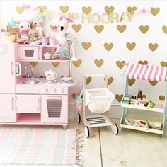 Such a fun play space!! I believe kitchen set is from kidcraft and decals from urban walls