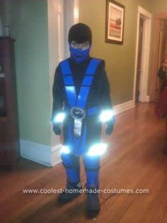 Homemade Sub-Zero and Scorpion Child's Couple Costume: Materials used for this Homemade Sub-Zero and Scorpion Child's Couple Costume:  Foam sheets Adhesive spray Old black dress pants Thread  Spray Paint (Blue/Yellow