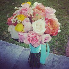 Peach, cream and pink roses with aqua satin ribbon bridal bouquet #sunpetalsflorist