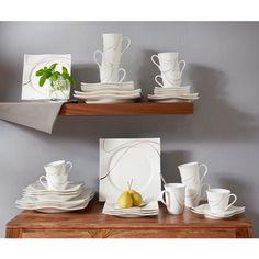 Mit diesem Tafelservice können Sie Ihre Gäste stilvoll bewirten. Das 36-teilige Set aus glänzendem Porzellan ist für 6 Personen ausgelegt und überzeugt durch sein elegantes Design. Das rechteckige Geschirr ist mit schwungvollen goldbraunen Verzierungen versehen und damit für festliche Anlässe optimal geeignet. Setzten Sie auf Markenqualität von RITZENHOFF & BREKER!
